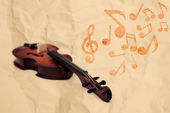 Violoncello with notes on crasshed paper — Stock Photo