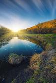 Puesta de sol sobre el río — Foto de Stock