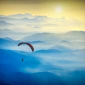 Paraglide silhouette in a light of sunrise — Stock Photo
