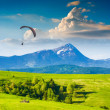 Flying over Carpathian spring mountain valley — Stock Photo #74114077