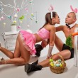 Couple in rabbit costumes with carrots and eggs — Stock Photo #65674141