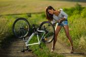 Woman pump it up Bicycle — Stock Photo