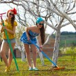 Girls raking soil in garden — Stock Photo #70284805