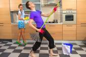 Funny couple on kitchen — Photo