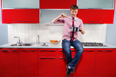 Hungry man in kitchen — Stock Photo