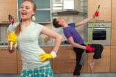 Funny couple on kitchen — Stockfoto