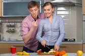 Lovely couple in kitchen — Stock Photo