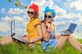 Two stylish girls in garden — Стоковое фото