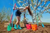 Girl with rakes and spade — Stok fotoğraf