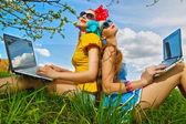 Two stylish girls in garden — Stock Photo