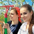 Young girls  with rakes — Stock Photo #70291007