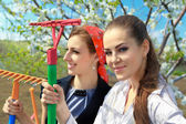 Young girls  with rakes — Stock Photo