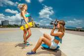 Two girls with skateboards — Stock Photo