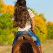 Woman in blue jeans riding  horse — Stock Photo #74215643