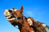 Beautiful girl riding  horse — Stock Photo