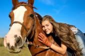 Girl riding  horse against blue sky — Stock Photo
