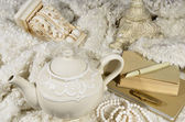 Teapot and wool fabric — Stock Photo