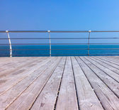 Wooden quay with handrails — Stock Photo