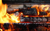 Charred wood in flames — Stock Photo