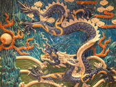 Dragon face on the wall — Stok fotoğraf