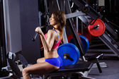 A young healthy athletic woman is training fitness at gym. — Stock Photo
