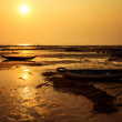 Lonely fisherman boats at a picturesque sea shore at orange suns — Stock Photo #69984021