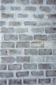 A closeup vertical image of old grey textured bricks wall. — Stock Photo