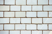 A closeup vertical image of old white textured bricks wall. — Stock Photo