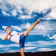 Young strong man is training taekwondo outdoors at beach — ストック写真 #78833154