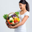 Woman shocked at her healthy basket — Stock Photo #64038295