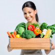 Healthy happy woman with crate of vegetables — Stock Photo #64038309