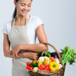 Woman with raw fresh produce in a basket  — Stock Photo #64038375