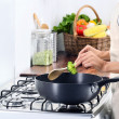 Woman  cooking and preparing meal — Stock Photo #64038565