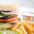 Burger and chips with sauce — Stock Photo #64038639