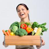 Joyful woman with fresh produce  — Stock Photo
