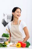 Smiling woman in the kitchen  — Stock Photo