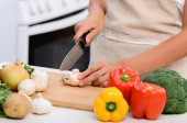 Hands slicing vegetables with knife — Stock Photo
