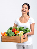 Smiling woman with fresh produce  — Stock Photo