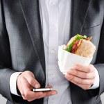 Businessman with take away lunch sandwich — Stock Photo #65458199