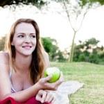 Woman eaten green apple — Stock Photo #65455577