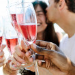 Friends toasting champagne sparkling wine — Stock Photo #65455605