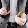 Businessman with take away lunch sandwich — Stock Photo #65456183