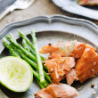 Gourmet salmon meal with asparagus and lime — Stock Photo #65456383