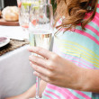 Close up of hand holding champagne glass — Stock Photo #65457265