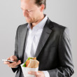 Businessman with take away lunch sandwich — Stock Photo #65457463