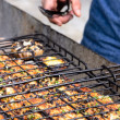 Grilling fish at a barbecue — Stock Photo #65457841