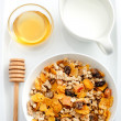 Healthy nutritious bowl of cereal with honey and milk — Stock Photo #65457929