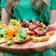 Variety of small canapes before the party — Stock Photo #65457955