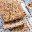 Healthy loaf of bread full of different seeds and nuts — Stock Photo #65458181