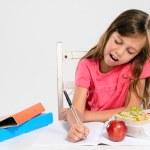 School girl does her homework — Stock Photo #65458435